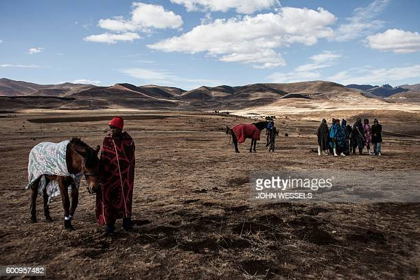 Jockeys wait for the race on July 16 2016 in Semonkong Horseracing in the mountain kingdom of Lesotho is not like at Ascot or Longchamp but it is...