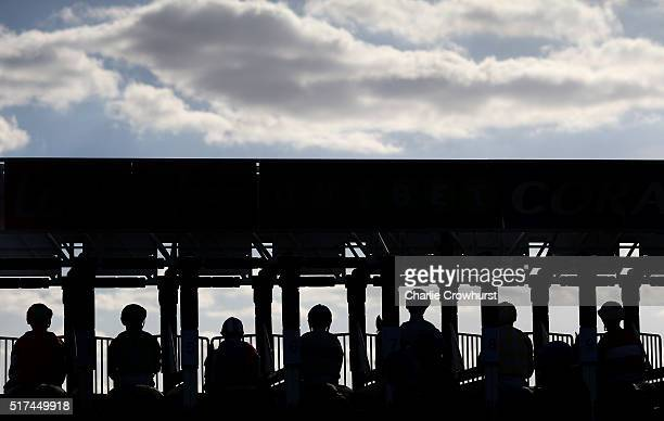 Jockeys wait in the stalls to begin the race during the All Weather Championships Finals Day at Lingfield Park on March 25 2016 in Lingfield England