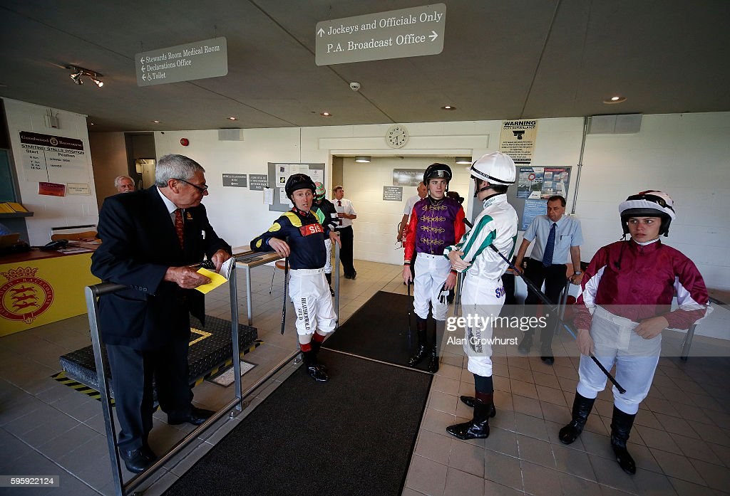 Jockeys wait in the weighing room to be called to the parade ring at Goodwood on August 26, 2016 in Chichester, England.