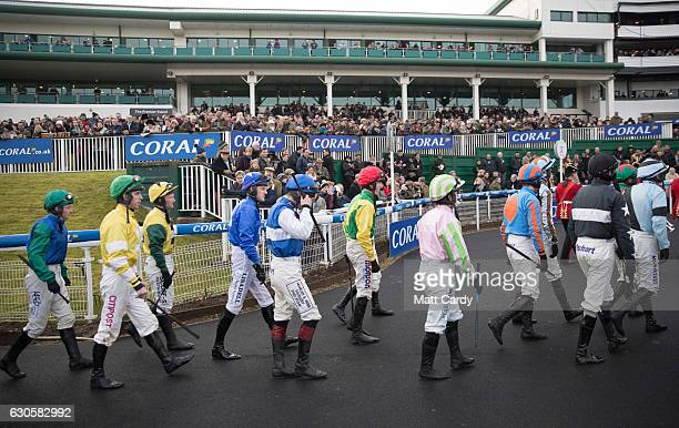 Jockeys walk into the parade ring ahead of the Welsh Grand National Handicap Steeple Chase during the 2016 Coral Welsh Grand National at Chepstow...