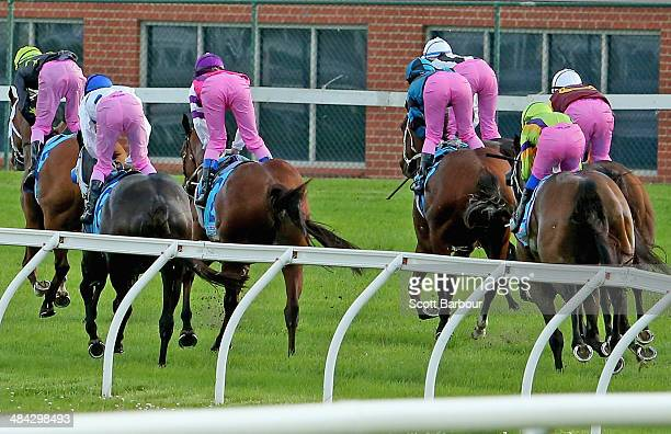 Jockeys wearing pink breeches in the name of breast cancer research finish the race during race 6 the 7Eleven Pink Ribbon Cup during 7Eleven Pink...