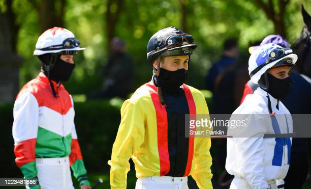 Jockeys wearing protective face mask in the parade ring on May 07, 2020 in Hanover, Germany. The performance test is the first horse race since the...