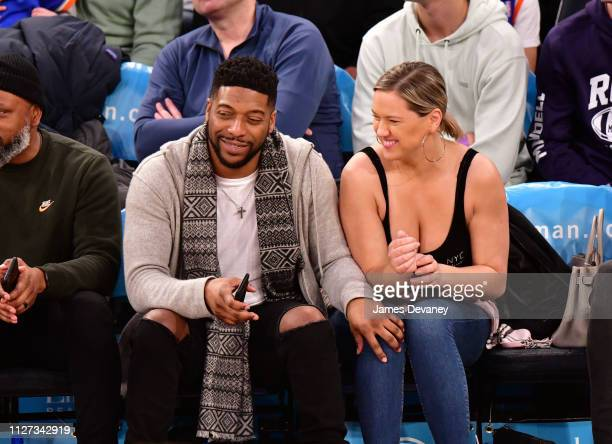 Jocko Sims and guest attend San Antonio Spurs v New York Knicks game at Madison Square Garden on February 24 2019 in New York City
