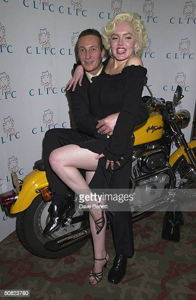 Jocky Richard Dunwoody with a Marilyn Monroe lookalike at the CLIC Charity Auction hosted by Eddie and Marie Jordan at Christie's on 22nd October...