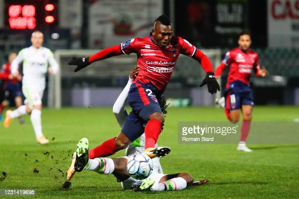 Jodel DOSSOU of Clermont and Ismael DOUKOURÉ of Valenciennes during the Ligue 2 BKT match between Clermont and Valenciennes on February 27, 2021 in...