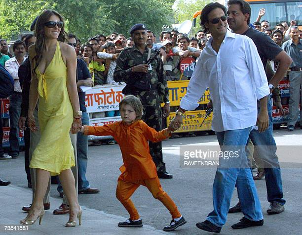 Indian businessman Arun Nayar walks with his wife Elizabeth Hurley and her son Damian as they arrive at Jodhpur Airport 10 March 2007 before boarding...