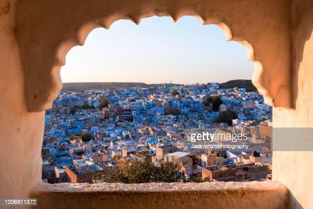 jodhpur, the blue city through window .rajasthan, india - jodhpur stock pictures, royalty-free photos & images