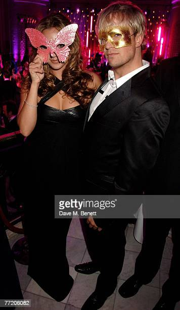 Jodi Albert and Kian Egan attend the cocktail party during The Pink Ice Ball In Aid Of Cancer Research UK at The Waldorf Hilton Hotel on October 5...
