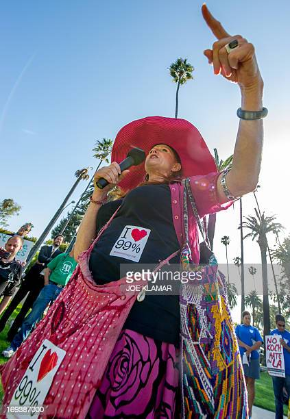 Jodi Evans of Code Pink Women for Peace delivers a speach during a protesters rally and march demanding Los Angeles Times not be sold to the Koch...