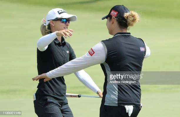 Jodi Ewart Shadoff of England and Ariya Jutanugarn of Thailand embrace on the 18th green during the final round of the HSBC Women's World...