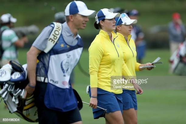 Jodi Ewart Shadoff of England and the European Team walks with Caroline Masson on the second hole in their match against Lexi Thompson and Cristie...