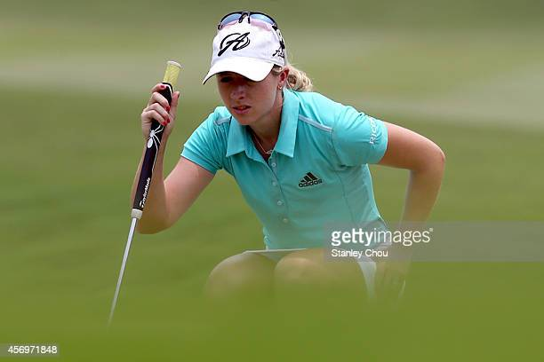 Jodi Ewart Shadoff of England lines for a putt on the 17th hole during day two of the Sime Darby LPGA at Kuala Lumpur Golf Country Club on October 10...