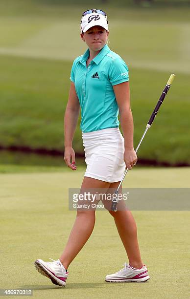 Jodi Ewart Shadoff of England reacts after her putt on the 18th hole during day two of the Sime Darby LPGA at Kuala Lumpur Golf Country Club on...