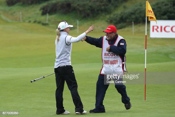 Jodi Ewart Shadoff of England reacts with her caddie on the 18th green during the final round of the Ricoh Women's British Open at Kingsbarns Golf...