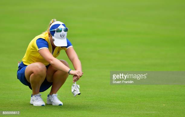 Jodi Ewart Shadoff of Team Europe reacts during the second day morning foursomes matches of The Solheim Cup at Des Moines Golf and Country Club on...