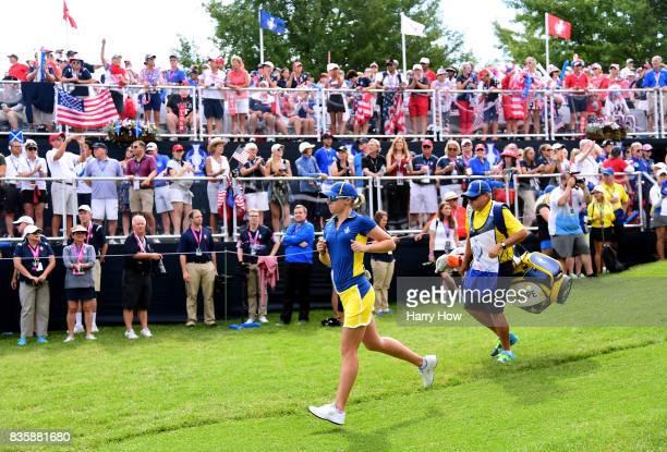 Jodi Ewart Shadoff of Team Europe runs off th first tee box with caddie Jeff Steffler in her match against Lizette Salas of Team USA during the final...
