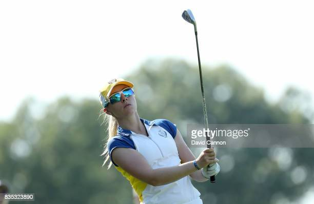 Jodi Ewart Shadoff of the European Team plays her second shot on the 12th hole in her match with Madelene Sagstrom against Michelle Wie and Danielle...