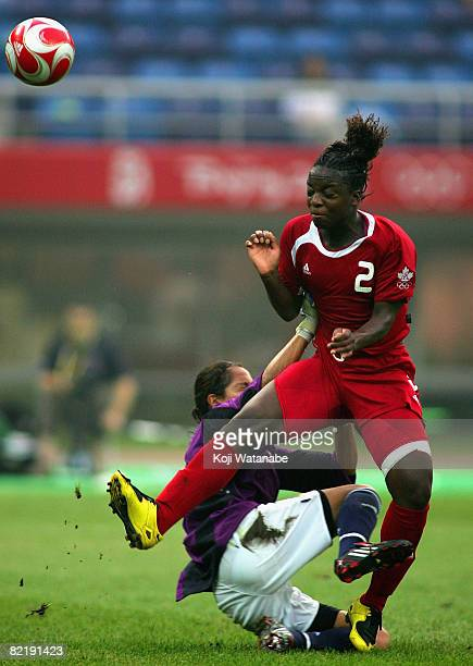 JodiAnn Robinson of Canada and Guadalupe Calello of Argentina clash during the Women's Group E match between Canada and Argentina on day 2 of the...