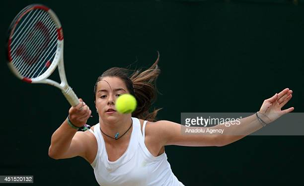 Jodie Anna Burrage returns the ball during her Ladies' Singles first round match against Turkey's Ipek Soylu during the 2014 Wimbledon Championships...