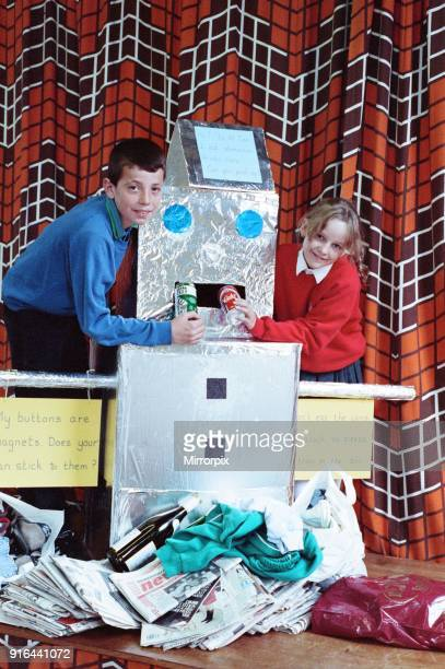Jodie Asquith and Richard Lomas add to the harvest collection at Scholes Junior and Infants' School The pupils decided to hold a recycling harvest...
