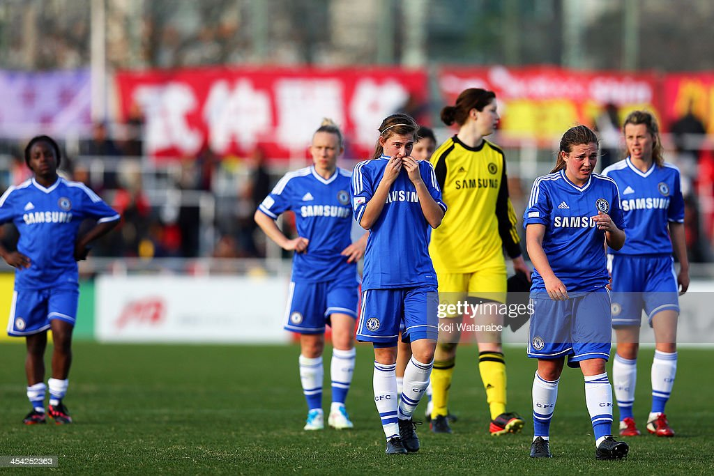 Jodie Brett #20 (C) and Rachel Williams #8 (R) of Chelsea Ladies look dejected after the International Women's Club Championship final match between Chelsea Ladies and INAC Kobe Leonessa at Ajinomoto Field Nishigaoka on December 8, 2013 in Tokyo, Japan.