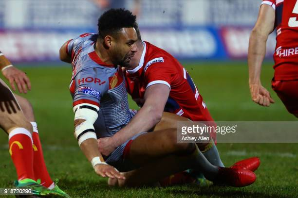 Jodie Broughton of the Catalans Dragons is tackled by Chris Clarkson of Hull KR during the BetFred Super League match between Hull KR and Catalans...
