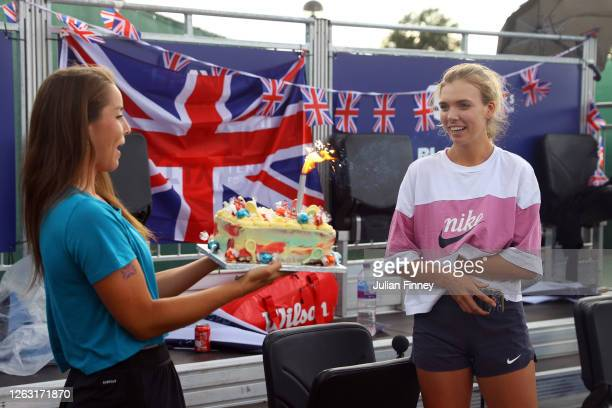 Jodie Burrage of Union Jacks hands over a birthday cake to teammate Katie Boulter during day six of the St James's Place Battle of The Brits Team...
