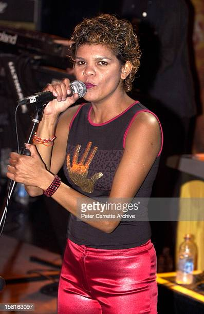Jodie CockatooCreed performs live on stage with the band Yothu Yindi at the 6th Annual Deadly Awards at City Live on October 22 2000 in Sydney...