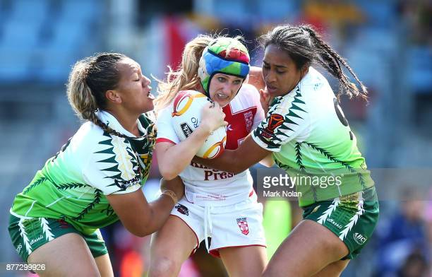 Jodie Cunningham of England is tackled during the Women's Rugby League World Cup match between England and the Cook Islands at Southern Cross Group...
