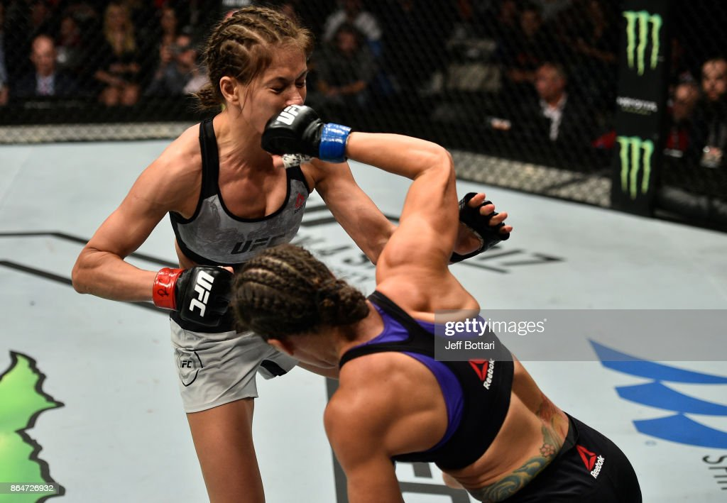 Jodie Esquibel punches Karolina Kowalkiewicz of Poland in their women's strawweight bout during the UFC Fight Night event inside Ergo Arena on October 21, 2017 in Gdansk, Poland.