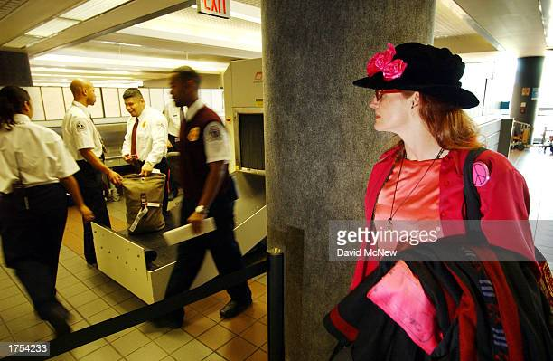 Jodie Evans cofounder of the peace activist group Code Pink looks on while her baggage is checked by security January 30 2003 at Los Angeles...