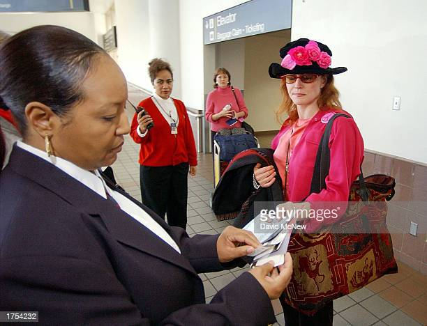 Jodie Evans cofounder of the women's peace activist group Code Pink shows her passport and flight ticket to security January 30 2003 at Los Angeles...