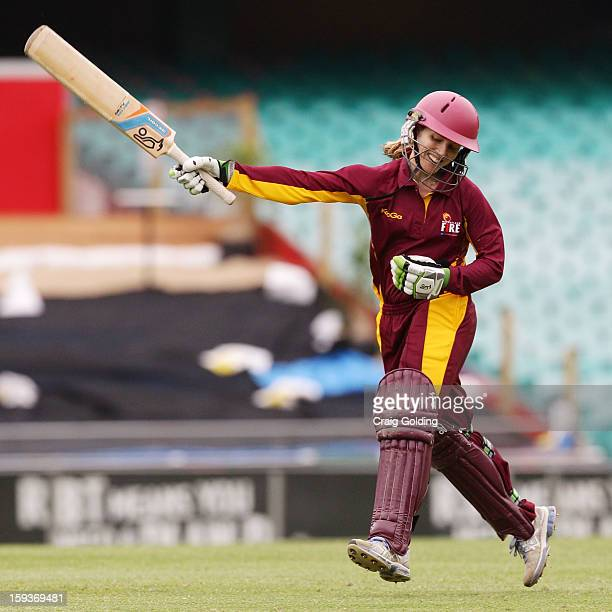 Jodie Fields celebrates on scoring a century during the WNCL Final match between the NSW Breakers and the Queensland Fire at the Sydney Cricket...