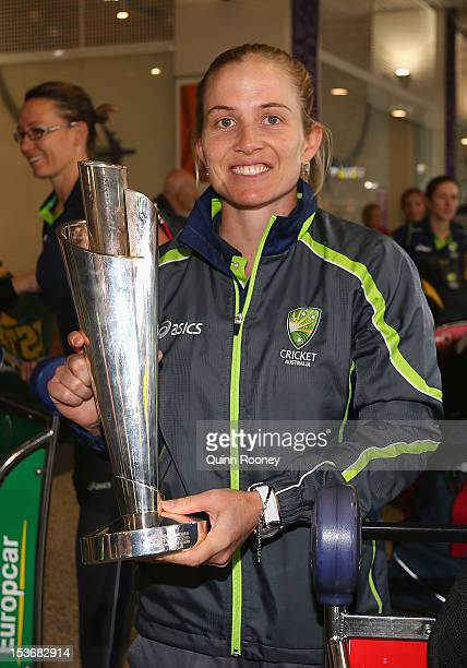 Jodie Fields of the Southern Stars poses with the trophy after arriving back home to Australia after winning the 2012 ICC Women's T20 World Cup at...