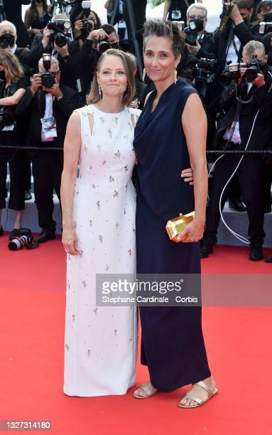 """Jodie Foster and Alexandra Hedison attend the """"Annette"""" screening and opening ceremony during the 74th annual Cannes Film Festival on July 06, 2021..."""
