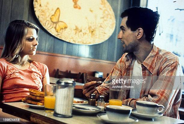 Jodie Foster and Robert De Niro at diner table in a scene from the film 'Taxi Driver' 1976