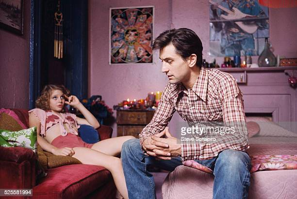 Jodie Foster and Robert De Niro talking in Iris' room during the filming of Martin Scorsese's Taxi Driver.