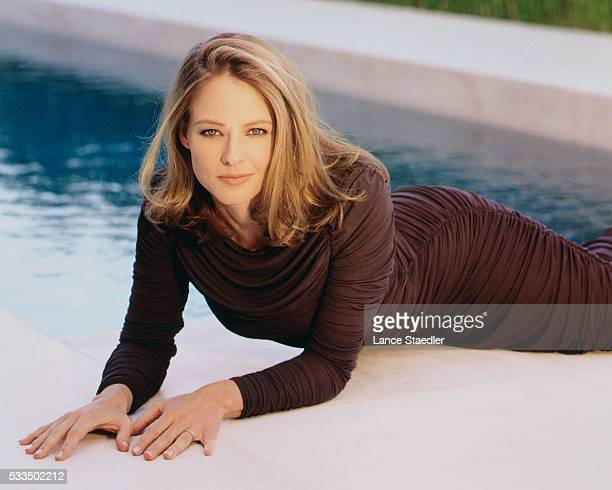 Jodie Foster Lounging in Brown Shirred Evening Gown