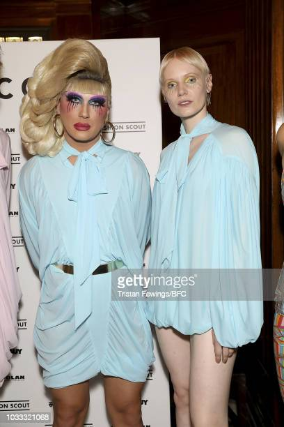 Jodie Harsh and a model backstage ahead of the Pam Hogg Show during London Fashion Week September 2018 at Freemasons Hall on September 14 2018 in...