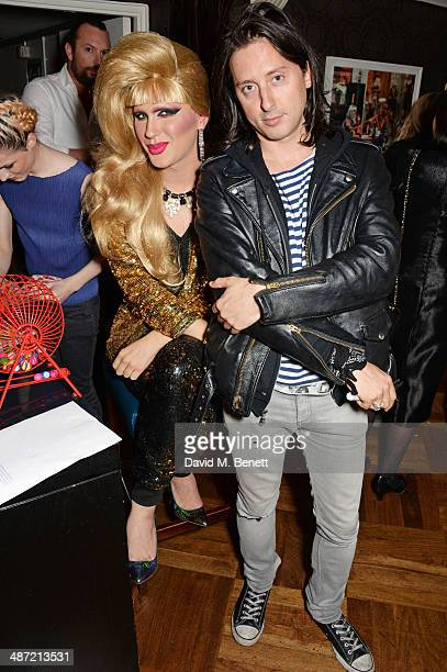 Jodie Harsh and Carl Barat attend The Hepatitis C Trust's Bingo Night at The Groucho Club on April 28 2014 in London England