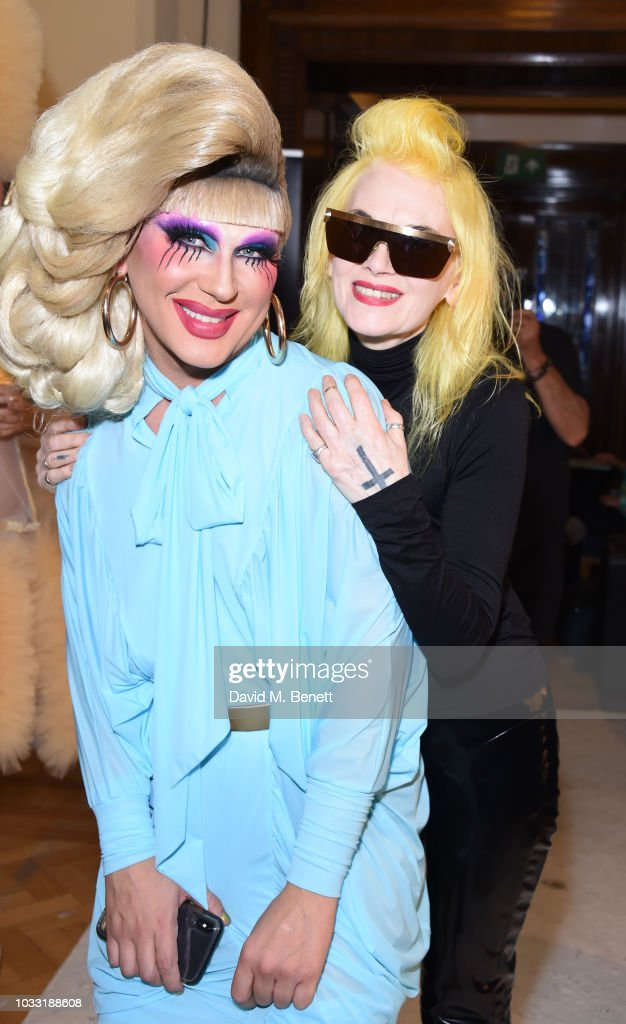 Jodie Harsh (L) and Pam Hogg pose backstage at the Pam Hogg show during London Fashion Week September 2018 at The Freemason's Hall on September 14, 2018 in London, England.