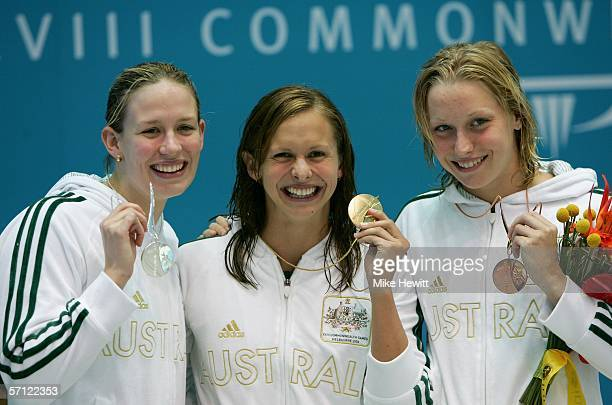 Jodie Henry of Australia Lisbeth Lenton of Australia and Alice Mills of Australia pose with their medals after the womens 100 metres freestyle final...