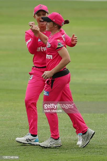 Jodie Hicks of the Sixers celebrates taking a catch to dismiss Tahlia McGrath of the Strikers during the Women's Big Bash League WBBL match between...