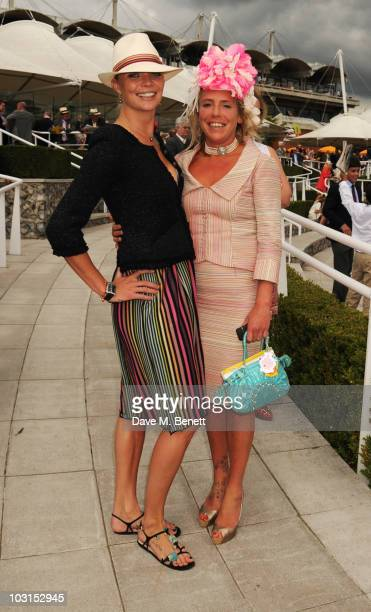 Jodie Kidd and Cozmo Jenks attend the Ladies Day at Glorious Goodwood at the Goodwood Racecourse on July 29 2010 in Chichester England