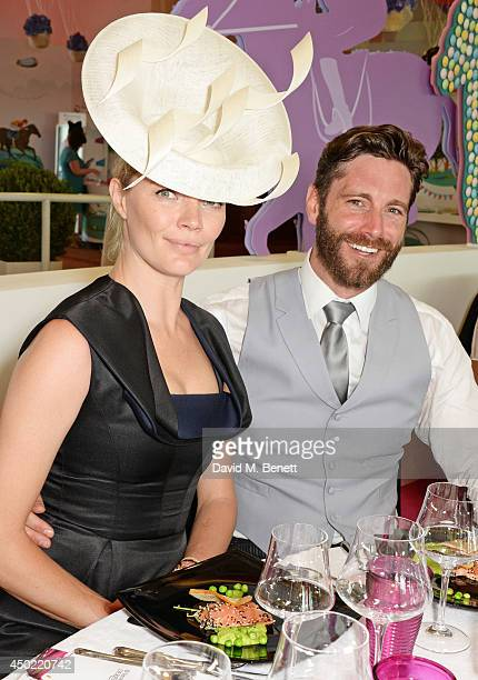 Jodie Kidd and David Blakeley attend Derby Day at the Investec Derby Festival at Epsom Downs Racecourse on June 6 2014 in Epsom England