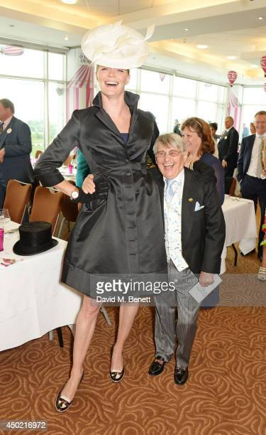Jodie Kidd and Willie Carson attend Derby Day at the Investec Derby Festival at Epsom Downs Racecourse on June 6, 2014 in Epsom, England.