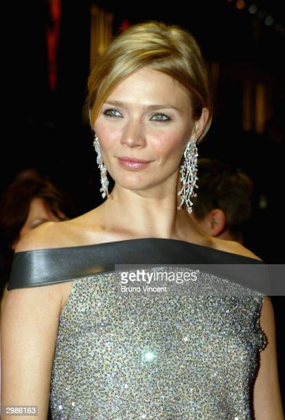 Jodie Kidd arrives at the The Orange British Academy Film Awards at the Odeon Leicester Square on February 15 2004 in London wearing earrings and...