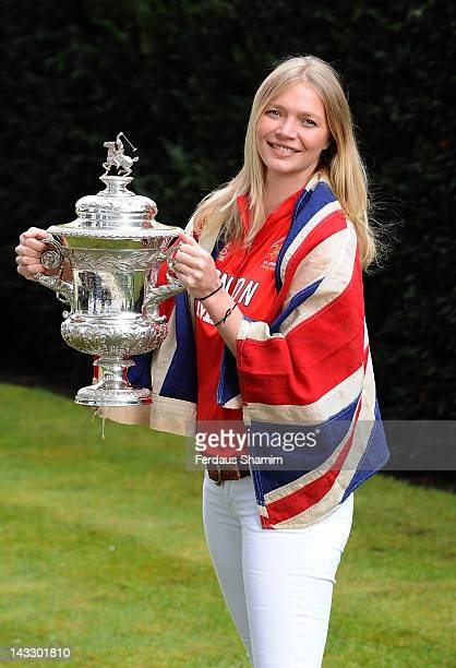 Jodie Kidd holds the Olympic Polo Trophy and wears the official Union flag which was flown at the 1936 Summer Olympics in Berlin as she attends the...