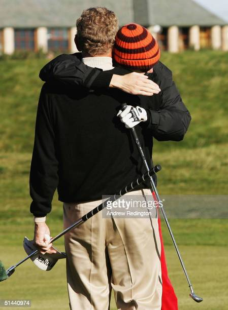 Jodie Kidd, the model, celebrates with Colin Montgomerie of Scotland after holing her third shot on the infamous 17th hole during the second round of...
