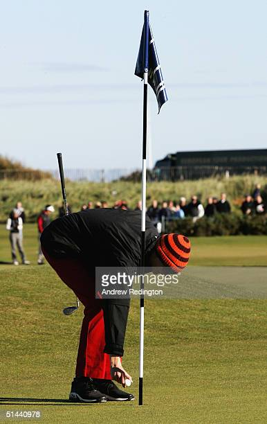 Jodie Kidd, the model, picks the ball out of the hole after holing her third shot on the infamous 17th hole during the second round of of the Dunhill...